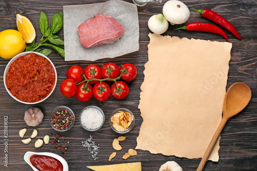 Canvas Kruiden 2 Composition of raw meat with vegetables and paper on wooden background