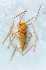 Waffle cones and sticks for ice cream.