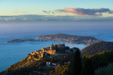 The Village of Eze (Èze), the Mediterranean Sea and Saint-Jean-Cap-Ferrat at sunrise. Alpes-Maritimes, French Riviera, France - 211175292
