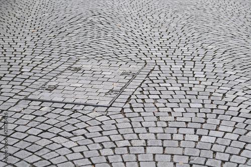 rectangular manhole in sett stone pavement - 211175426