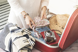 Woman preparing summer luggage - 211176231