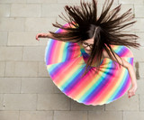 girl in rainbow dress spinning - 211176277