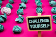 Text sign showing Challenge Yourself. Conceptual photo Overcome Confidence Strong Encouragement Improvement Dare Blackboard with white letter pink base much green paper lobs big white lob.