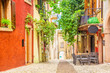 Leinwanddruck Bild - Small town narrow street view with colorful houses in Malcesine, Italy during sunny day. Beautiful lake Garda.