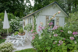 Weathered wood and shutters with summer flowers on a Maine Cottage - 211189273
