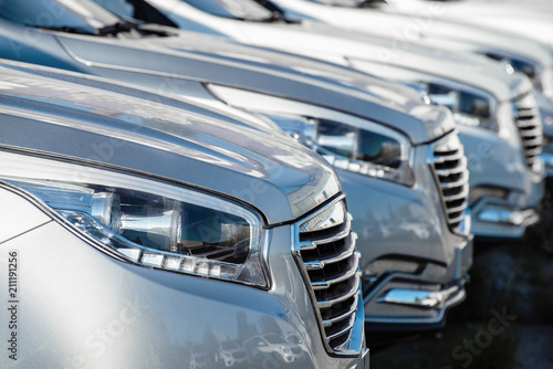 cars located row at shallow depth of field - 211191256