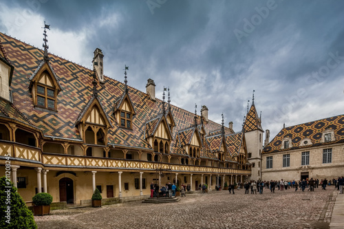 Beaune, France May 19th 2013 : The beautiful Hotel Dieu hospital museum at Beaune, famous for its polychrome roof architecture