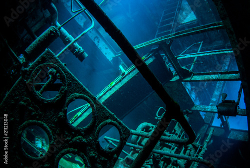 Aluminium Schipbreuk An underwater shot inside a room in the shipwreck of the Kittiwake that uses natural light as opposed to a strobe. The wreck has been sunk deliberately and is shallow enough to allow light penetration