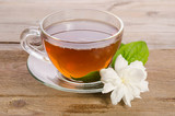 Glass cup of Tea with jasmine flowers on wooden table - 211228842