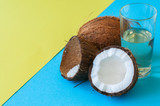 Coconut water, whole coconuts on a duo tone background. Coconut products concept.