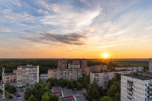 RUSSIA, MOSCOW, TROITSK - JUNE 28, 2018: View from the high on Mikroraion V street district and clouds on sky aver the forest horizon at sunset time in summer