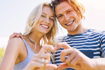 Loving couple making hand heart