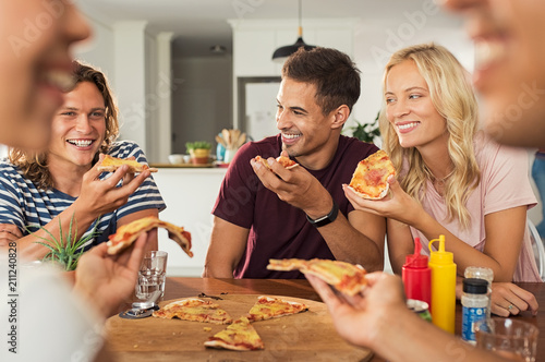 Friends eating pizza at home - 211240828