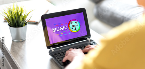 Online music concept on a laptop screen - 211249875