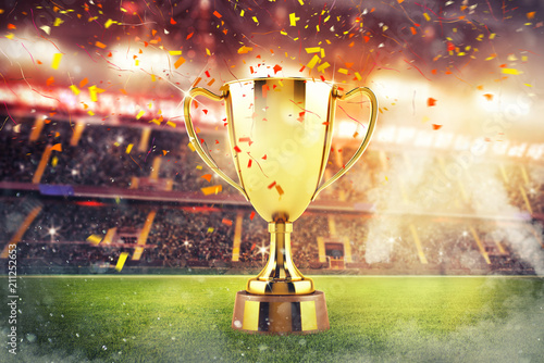 Leinwanddruck Bild Golden winner's cup in the middle of a stadium with audience