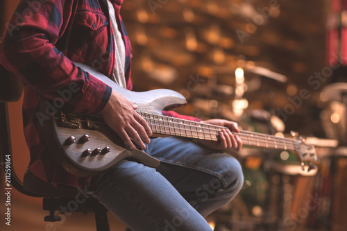 Young musician with bass guitar - 211259864