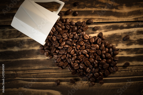 Fotobehang Koffiebonen roasted coffee beans and cup bottle good smell aroma drinking in morning for wake up
