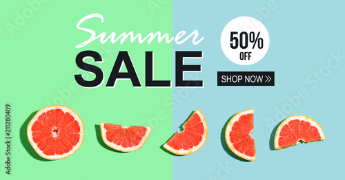 Summer sale message with halved fresh grapefruits - 211280409