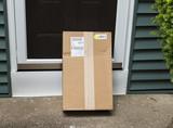 Package left at front door - 211289406