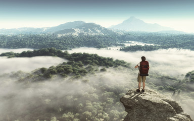 Hiker on the top of the mountain looking at the landscape © Orlando Florin Rosu