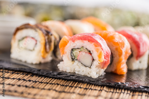 Fotobehang Sushi bar Set of roll sushi gold california with chopsticks and soy sauce.