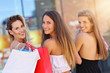 Quadro Happy girl friends shopping in mall