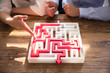 Close-up Of Maze Puzzle With Red Arrow