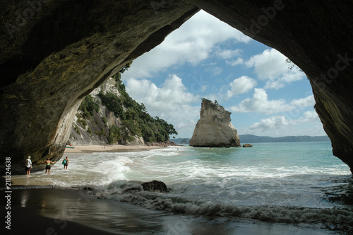 Fotobehang Cathedral Cove Cathedral Cove pictured from within the arch looking north along the sandy beach to the sea stack. Near Hahei, Coromandel, New Zealand.