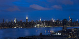 JUNE 3, 2018 - NEW YORK, NEW YORK, USA  - New York City and East River shows Chrysler Building on right and Empire State Building on Left, as seen from Queens - 211338605