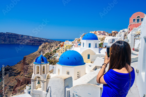 Famous blue domes of Santorini photographed by tourist - focus on domes, Greece © Pawel