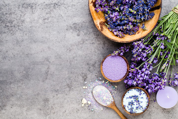 Essential lavender salt with flowers top view. © gitusik