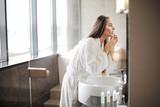 Pretty woman in the bathroom - 211375093