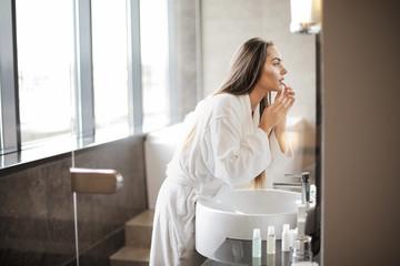 Pretty woman in the bathroom © olly