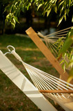 Element, detail, light hammock made of natural materials. Ropes, white cotton and wood. Rest in the garden, in the country - 211381685