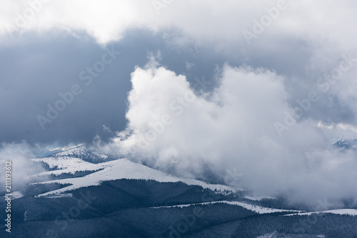 Winter landscape with fog in the mountains - 211393612