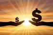 Silhouette of two hands, in one hand a large symbol of Dollar. In the second hand is a small symbol of the dollar