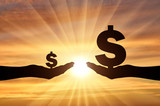 Silhouette of two hands, in one hand a large symbol of Dollar. In the second hand is a small symbol of the dollar - 211395219