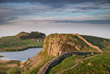 Beautiful landscape image of Hadrian's Wall in Northumberland at sunset with fantastic late Spring light - 211402456