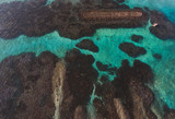 Aerial drone top view of the beautiful ocean lagoon and reef