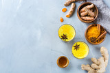 Traditional indian drink turmeric curcuma golden milk with ingredients - 211411424