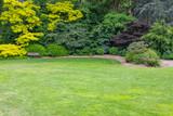 Beautiful Green Garden Setting With Wood Bench - 211413641