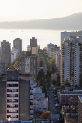 Aerial view of the Downtown City Residential Buildings during a sunny sunset. Taken in Vancouver, BC, Canada.