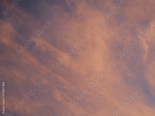 Fototapeta Tokyo,Japan-June 30, 2018: Dramatic sunrise sky with colorful clouds like abstract painting