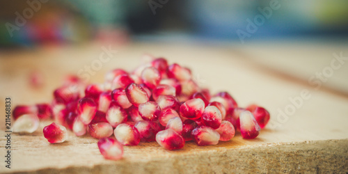 Foto Murales pomegranate - tasty and ripe red grain (harvest). food background