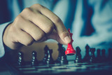 man hand playing chess board, concept of business strategy and tactic