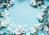 Pastel flowers blooming frame on blue background, top view - 211481099