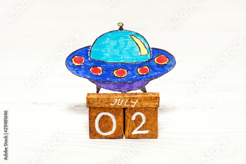 Aluminium UFO Jule 2nd - World UFO Day on wooden calendar