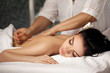 Relaxed woman receiving massage
