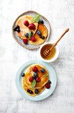 Homemade pancakes with berry fruits, honey and mint leaves. Flat lay. Healthy food. Brinner - 211497464