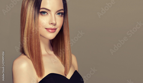 Leinwanddruck Bild Beautiful model girl with shiny brown and straight long  hair .Keratin  straightening .Treatment, care and spa procedures.Medium length hairstyle. Coloring, ombre,and highlighting